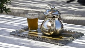Moroccan tea pot with mint tea and glas