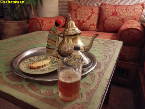 Moroccan mint tea in teapot with glasses on table